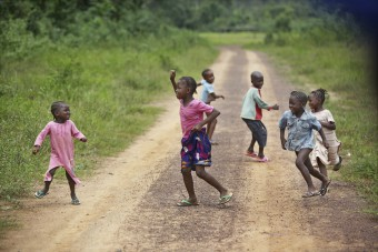 Children play on the main road into Sackie Town in Montserrado County, Liberia.