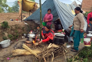 Families sleeping and cooking outside in Kathmandu Valley