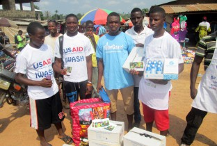 Youths raising awareness on Ebola in a marketplace in Voinjama,
